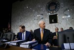 Sen. Orrin Hatch (R-Utah) chairs a Senate Finance Committee executive session on tax policy, on Capitol Hill in Washington, Nov. 15, 2017. Senate Republicans have decided to include the repeal of the Affordable Care Act's requirement that most people have health insurance into the sprawling tax rewrite. At left is Sen. Ron Wyden (D-Ore.), the ranking Democrat on the committee.