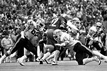 Three Washington State defenders surround Washington running back Sterling Hinds as Cougars safety Paul Sorensen (28) closes in on the play during the 1981 Apple Cup at Husky Stadium, won 23-10 by the UW.