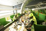 Presort Lead Jameel Henricksen, right, and Sorter Jerome Thomas remove plastic bags at Waste Management's SMaRT Center in Spokane.