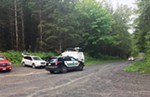 The authorities responding near Lake Hancock, northeast of Snoqualmie, Wash., where a cougar attacked two bicyclists on Saturday, killing one of them.