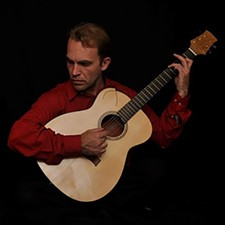 jonathan_red_guitar_jpg-magnum.jpg