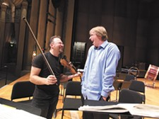 YOUNG KWAK - Spokane Symphony concertmaster Mateusz Wolski, left, and Music Director Eckart Preu share a laugh during rehearsals in 2014.