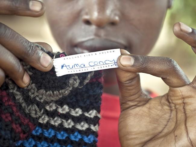 Ugandan Auma Concy shows off her handiwork. - KROCHET KIDS INTERNATIONAL