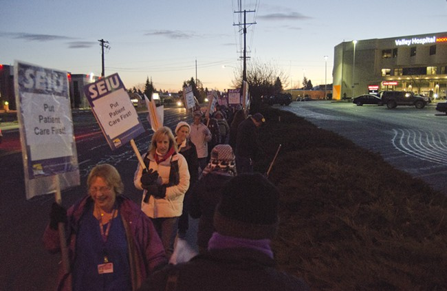 Union members and supporters march outside Valley Hospital as the sun comes up on Wednesday. - JACOB JONES