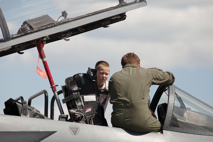 U.S. Air Force 389th Fighter Squadron Capt. Dan Hendren, right, shows the cockpit of his F-15E to 12-year-old Preston Johnson. - YOUNG KWAK