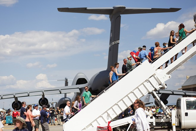 Visitors line up to enter a KC-10. - YOUNG KWAK