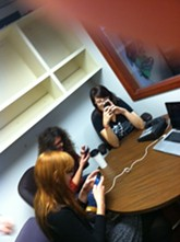The Inlander's arts staff (Tiffany, Jordy, Leah and my thumb) fire up their smartphones for tonight's tweeting.