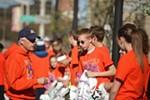 Volunteers hold bags of belongings for elite runners.
