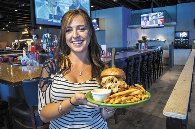 Waitress Summer Williamson with the massive Angry Lucy burger at 50/Fifty. - SARAH WURTZ