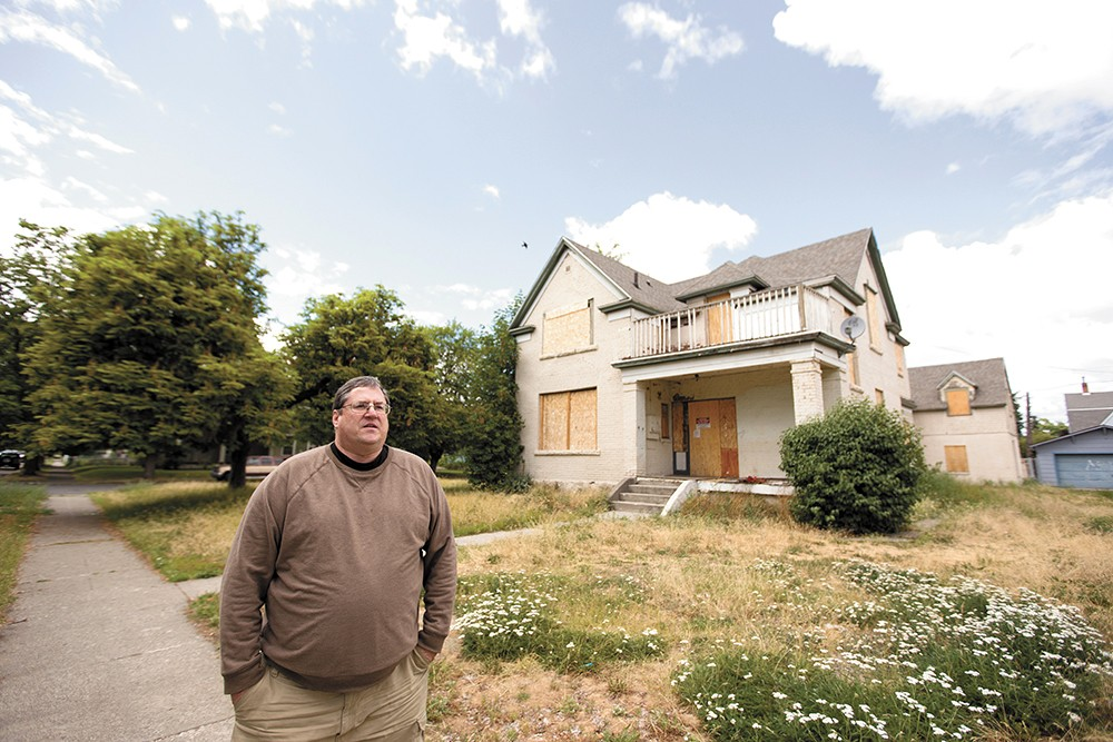 """West Central neighborhood leader Kelly Cruz says he hopes designating some dilapidated houses """"blighted"""" could lead to improvement. - YOUNG KWAK"""