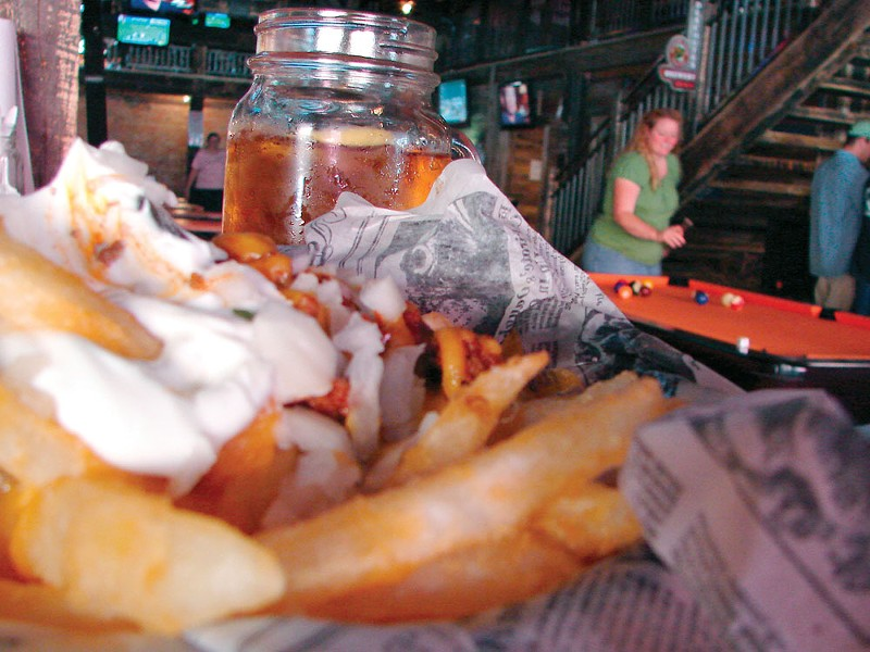 What's that? Behind the White Trash Chili Cheese Fries? A mason jar of beer? Why yes, we think it is. - CARRIE SCOZZARO