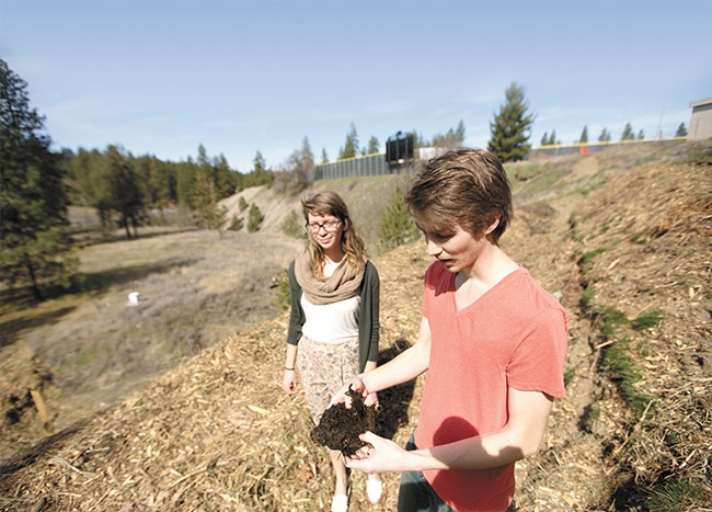 Whitworth Community Garden president Chris Grochowski inspects composted materials with vice president Michelle Youngblom. - YOUNG KWAK