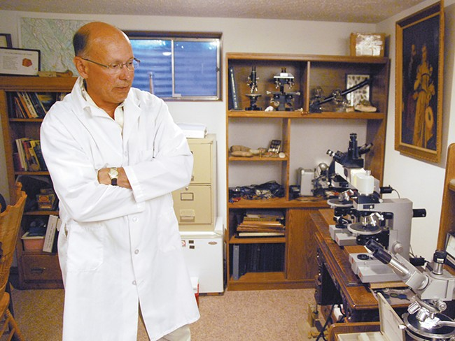 "William Schneck, in his basement lab: ""I\'m searching for truth and justice."" - BEN CRIST"