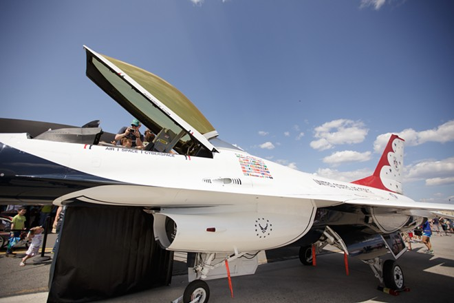 William Wadmer, top, takes a photo of the cockpit of a U.S. Air Force Thunderbirds Air Demonstration Squadron F-16. - YOUNG KWAK