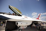 William Wadmer, top, takes a photo of the cockpit of a U.S. Air Force Thunderbirds Air Demonstration Squadron F-16.
