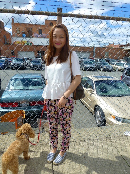 Xing Zhang and her pup supported their ballers while wearing some trendy summer pieces. '90s floral made a huge appearance this Hoopfest. - MADISON BENNETT