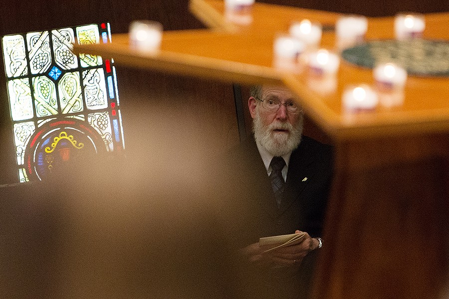 Yom HaShoah Planning Committee member Hershel Zellman watches a speaker. - YOUNG KWAK