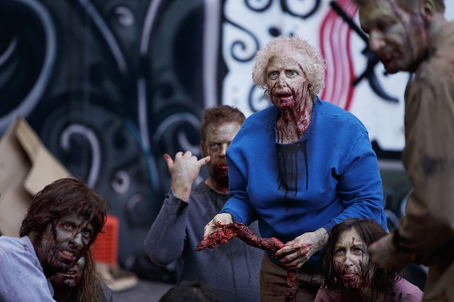 Zombie extra Susan Cleveland, second from the right, prepares for a scene. - YOUNG KWAK