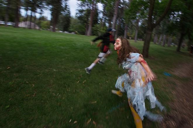 Zombie Sydney Travis chases race participants. - YOUNG KWAK