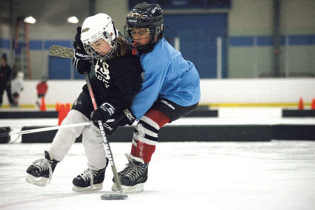 CSB U8 players fight for the puck during practice. - MATTHEW THORSEN