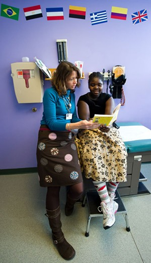 Dr. Andrea Green with Kamikazi Odreille, 12, of Burlington, reading Ramona Quimby, Age 8 - ANDY DUBACK