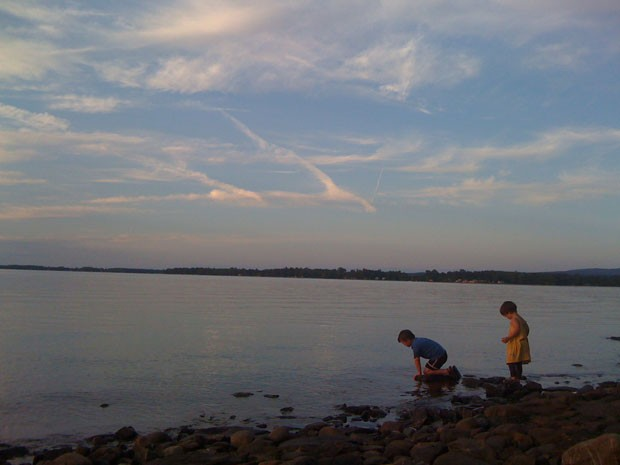 Graham and Ivy Resmer explore the water's edge at Burton Island State Park