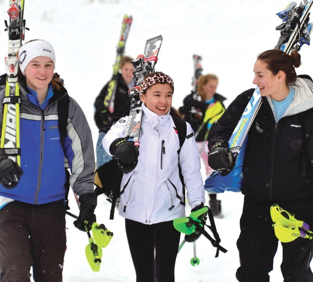 Green Mountain Valley students Kara Gailiunas, Sophia Meynard and Ali Nullmeyer head for the school bus after training at Sugarbush's Mt. Ellen