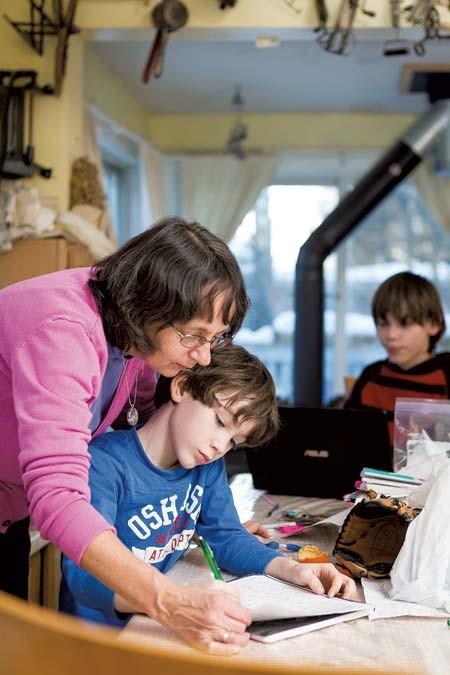 Hamlin helps Zachary, 8, with homework