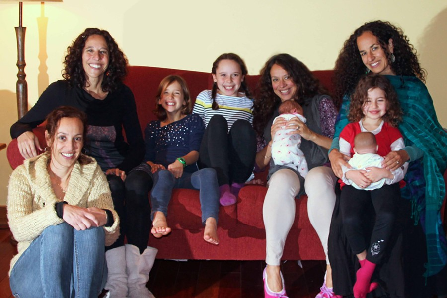 Jessica with her three sisters and four daughters — plus a baby doll!
