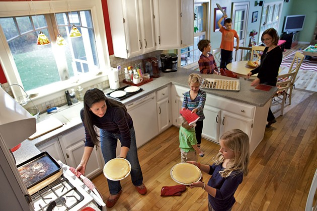 Juanita Galloway in her kitchen with business partner Anne Marcoe and their five kids, (bottom to top) Claire Marcoe, Theo Galloway, Georgia Marcoe, Henry Marcoe and Henry Galloway.