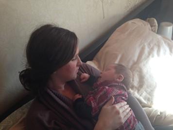 Julia snuggling baby Rowan.