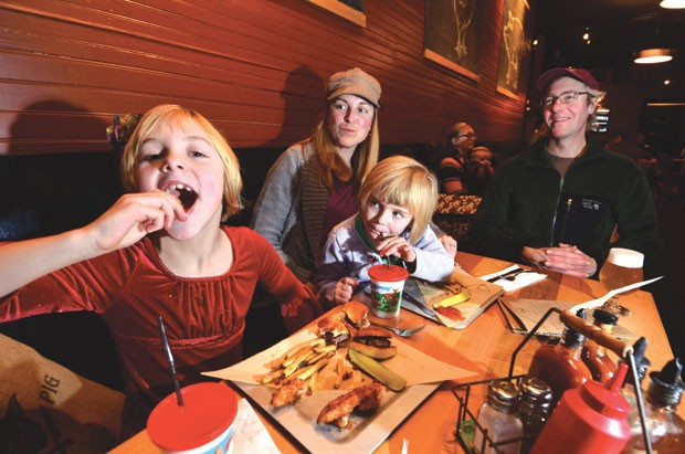 Karen and Sean Lawson of Warren enjoy dinner with their daughters Ava, left, and Jade.