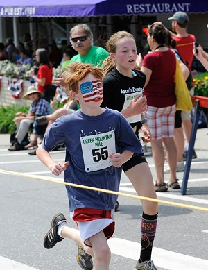 COURTESY OF GORDON MILLER - Kids break into a run at last year's Green Mountain Mile