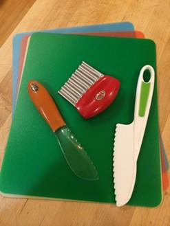 Kids' cooking implements that won't cut off little fingers.