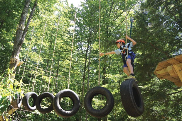 Kieran Tharp on the ArborTrek Treetop Obstacle Course