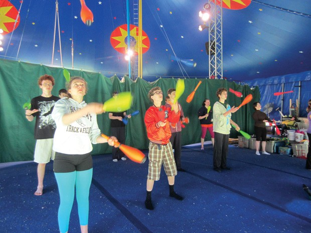 Learning how to juggle at Circus Smirkus