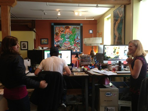 Meredith Coeyman, John James and Brooke Bousquet work on scoring our cover illustration.