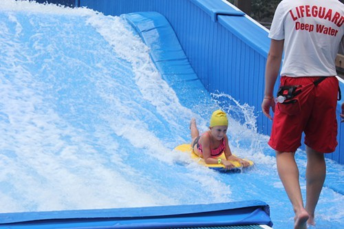 Mira Novak on the Double Barrel Flowrider