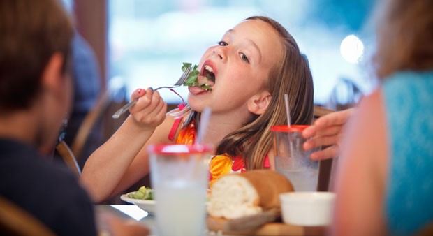 Olivia Ste. Marie, 8, from Guilford, Conn. enjoys a salad at One Federal in St. Albans. The family dined on a recent kids-eat-free Tuesday.