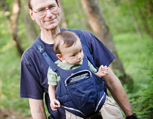 Paul Oszurek with 10-month-old Ethan in front pack - STINA BOOTH