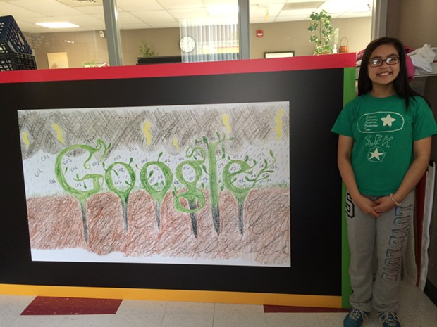 Penny Ly with a blown-up version of the Google logo she designed.