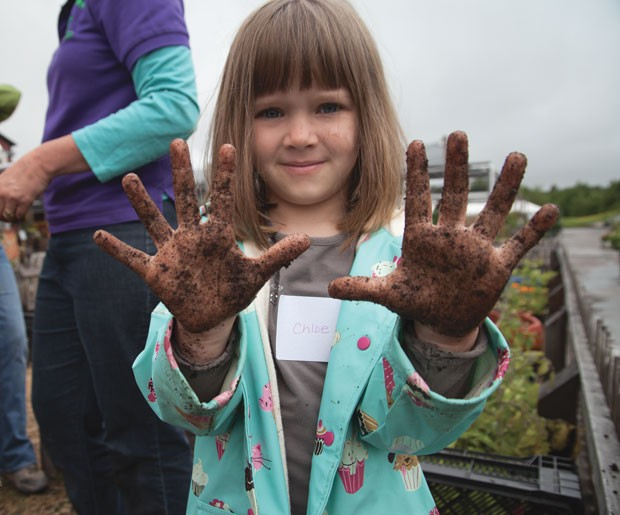Planting flowers at Gardener's Supply Company's Kids Club