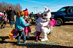 The Easter Bunny greets kids at the Milton Park and Rec egg hunt. - COURTESY OF MILTON PARKS AND REC