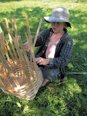 Rye Hewitt making a pack baskett