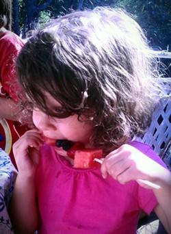 Sadie with fruit kebob - ERINN SIMON