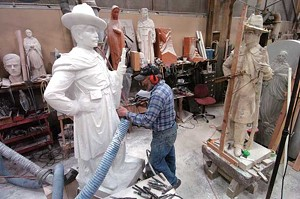 Sculptor Stanislaw Lutostanski works on a monument