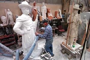 Sculptor Stanislaw Lutostanski works on a monument