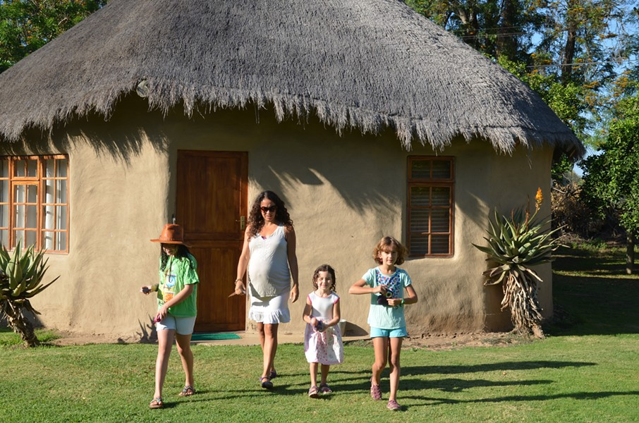 Staying in a rondavel, a traditional Xhosa thatched-roof round hut made from mud.