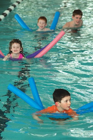 MATTHEW THORSEN - Swim students practice their paddling at a Learning Pool class