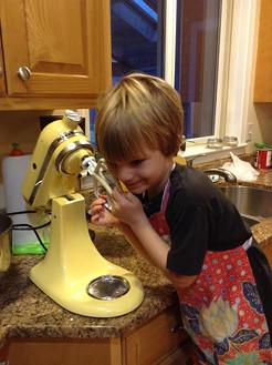 Theo, showing the (unplugged) KitchenAid a little love.
